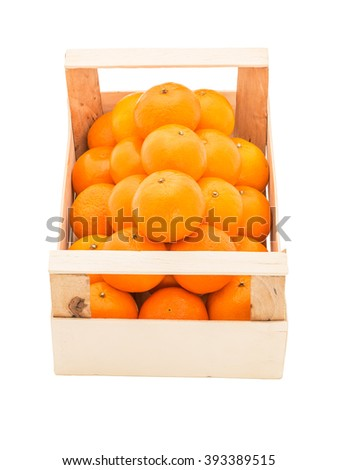 Ripe, juicy tangerines in a wooden box stacked as pyramid, on a white background - stock photo