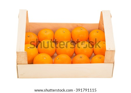 Ripe, juicy tangerines in a wooden box, stacked in a one row and photographed on a white background. Front view - stock photo