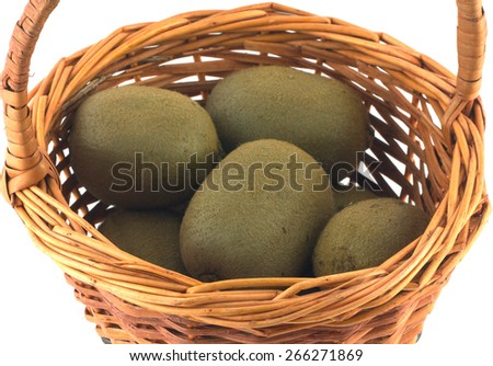 Ripe kiwi fruits in brown wicker basket isolated on white close up - stock photo