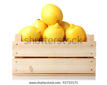 ripe lemon in wooden box isolated on white - stock photo