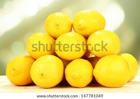 Ripe lemons on table on bright background