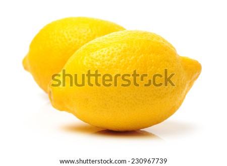Ripe lemons on white background - stock photo