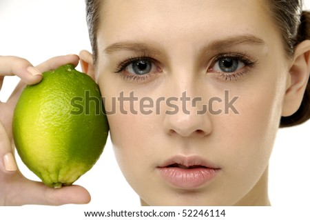 Ripe lime in female hand. close up - stock photo