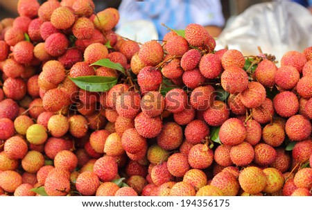 ripe lychee in the market - stock photo