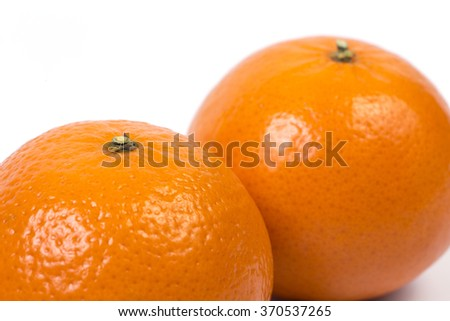 Ripe mandarin closeup on white background