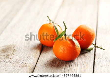Ripe mandarin on a grey wooden table - stock photo