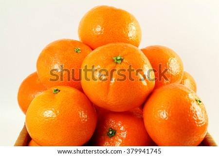 Ripe mandarin  tangerine orange closeup on a white background - stock photo