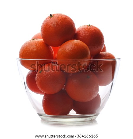 Ripe mandarins in glass bowl isolated  on white background - stock photo