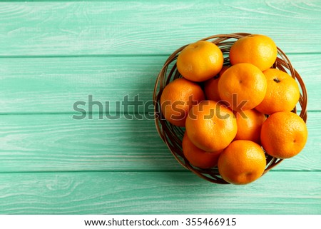 Ripe mandarins on a mint wooden table - stock photo