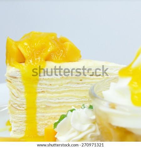Ripe mangoes crape-cake, favourite dessert. - stock photo
