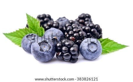 Ripe mix berries closeup on white. Sweet blueberries and blackberries isolated on white.