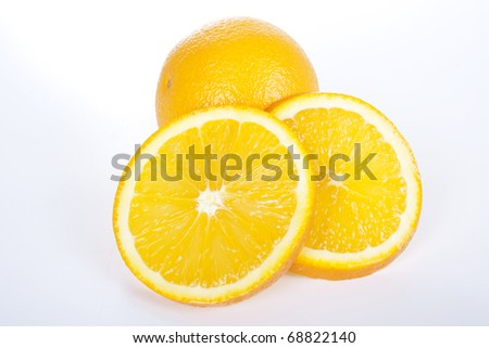 Ripe orange and two slices on white background
