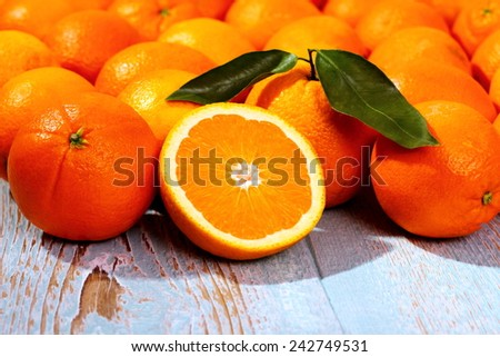 Ripe orange fruit on wooden board as background, close up - stock photo