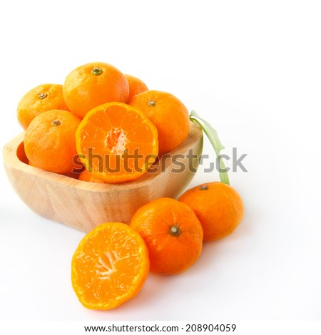 Ripe orange fruits on white background