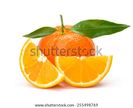 Ripe orange whit slices and leaves - stock photo