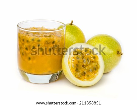 Ripe passion fruit with passion fruit juice  isolated on white background. - stock photo