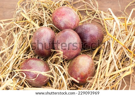 Ripe passion fruits on a wooden background.