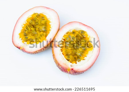 Ripe passion fruits on white background - stock photo