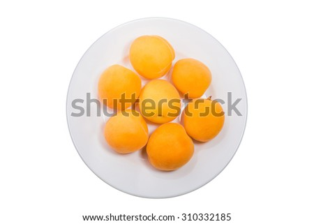 ripe peach in white glass plate on white table - stock photo