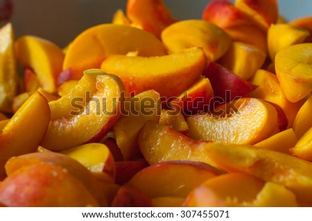 Ripe peach slices. Fresh organic fruits. Cooking jam background. - stock photo