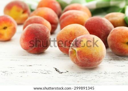 Ripe peaches fruit on a white wooden background - stock photo