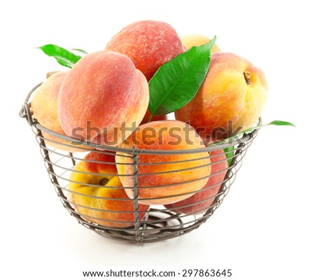 Ripe peaches in basket isolated on white - stock photo