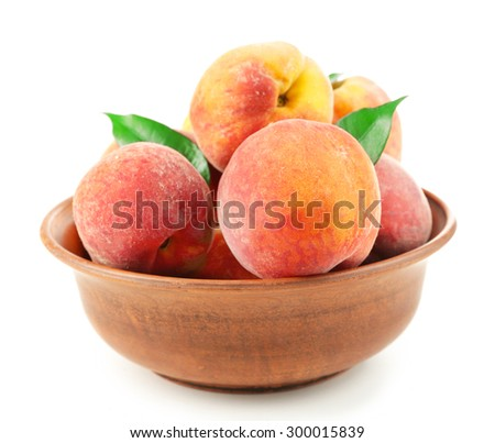 Ripe peaches in bowl isolated on white - stock photo