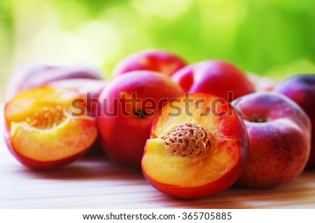 ripe peaches in green background - stock photo