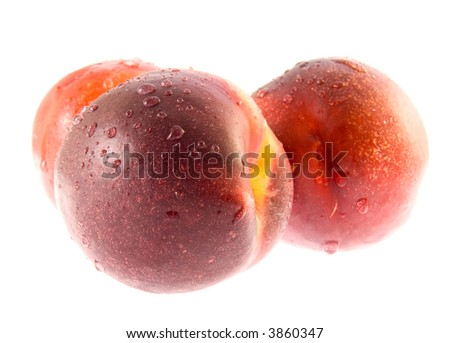 Ripe peaches in water droplets on white background (isolated)