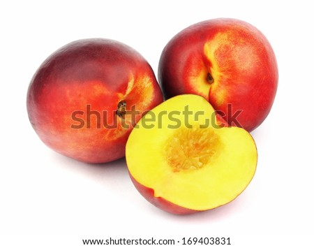 Ripe peaches isolated on white background