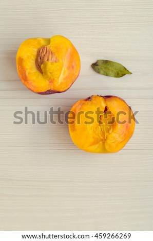 Ripe peaches on white wooden background. Group of fresh peaches on white table. Juicy and fresh peach with place for text. Concept for healthy eating and nutrition. Top view. Copy Space. - stock photo