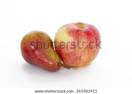 Ripe pear and apple on a white background - stock photo