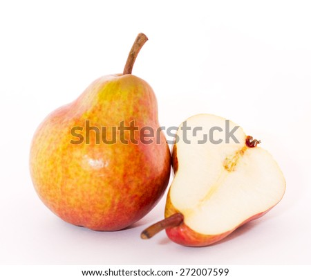 Ripe pear and half a pear on a white background - stock photo