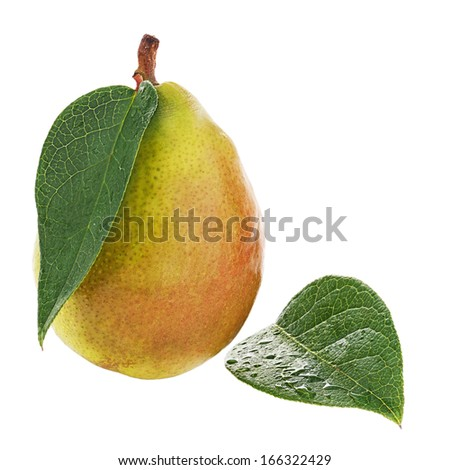 Ripe pear with green leaves isolated on white background. Closeup.