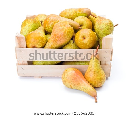 Ripe pears in wooden crate. Pyrus communis - stock photo