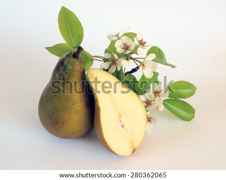 Ripe pears one sliced and branch with blossoms     - stock photo