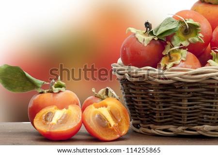 ripe persimmons - stock photo