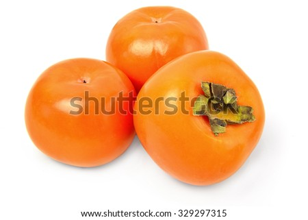 Ripe persimmons isolated on a white cutout.