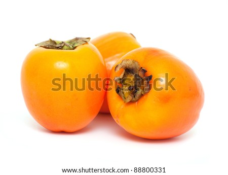 ripe persimmons on white background - stock photo