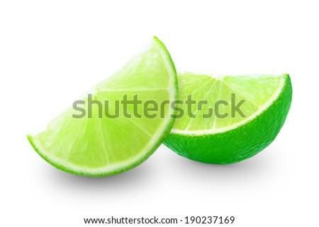 ripe pieces of lime on white background