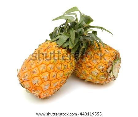 Ripe pineapple fruits isolated on white background - stock photo