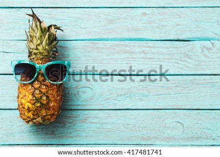 Ripe pineapple on a old wooden table - stock photo