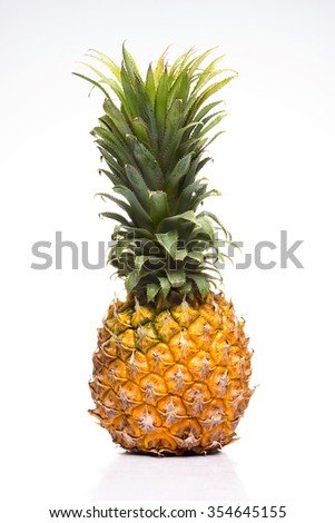 Ripe pineapple yellow color, white, with green leaves withered by time.