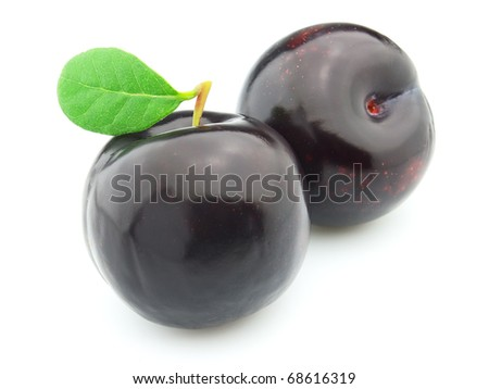 Ripe plum with leaves - stock photo