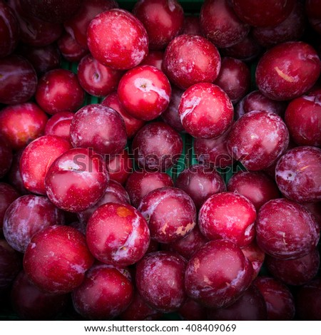 Ripe Plums Background.  Fresh ripe red plums - stock photo