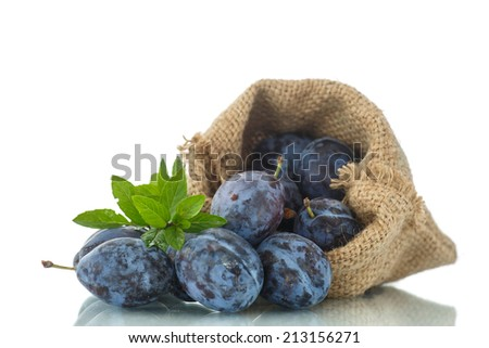 ripe plums in a bag on a white background - stock photo