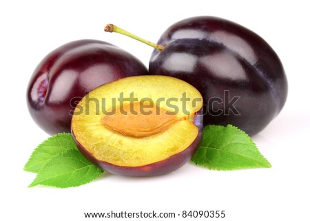 Ripe plums with leaves - stock photo