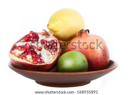 Ripe pomegranate and lrmone  fruit isolated on white background cutout - stock photo