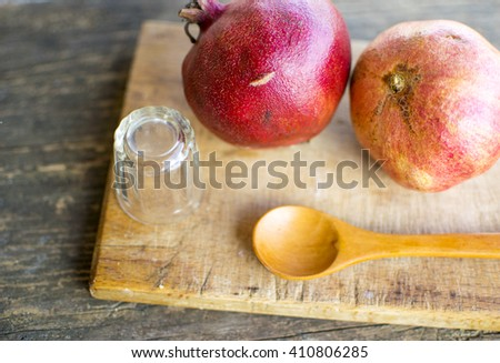 Ripe pomegranate fruit on wooden vintage background. - stock photo