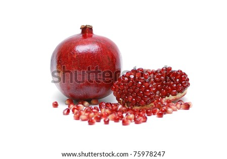 Ripe pomegranate on a white background - stock photo